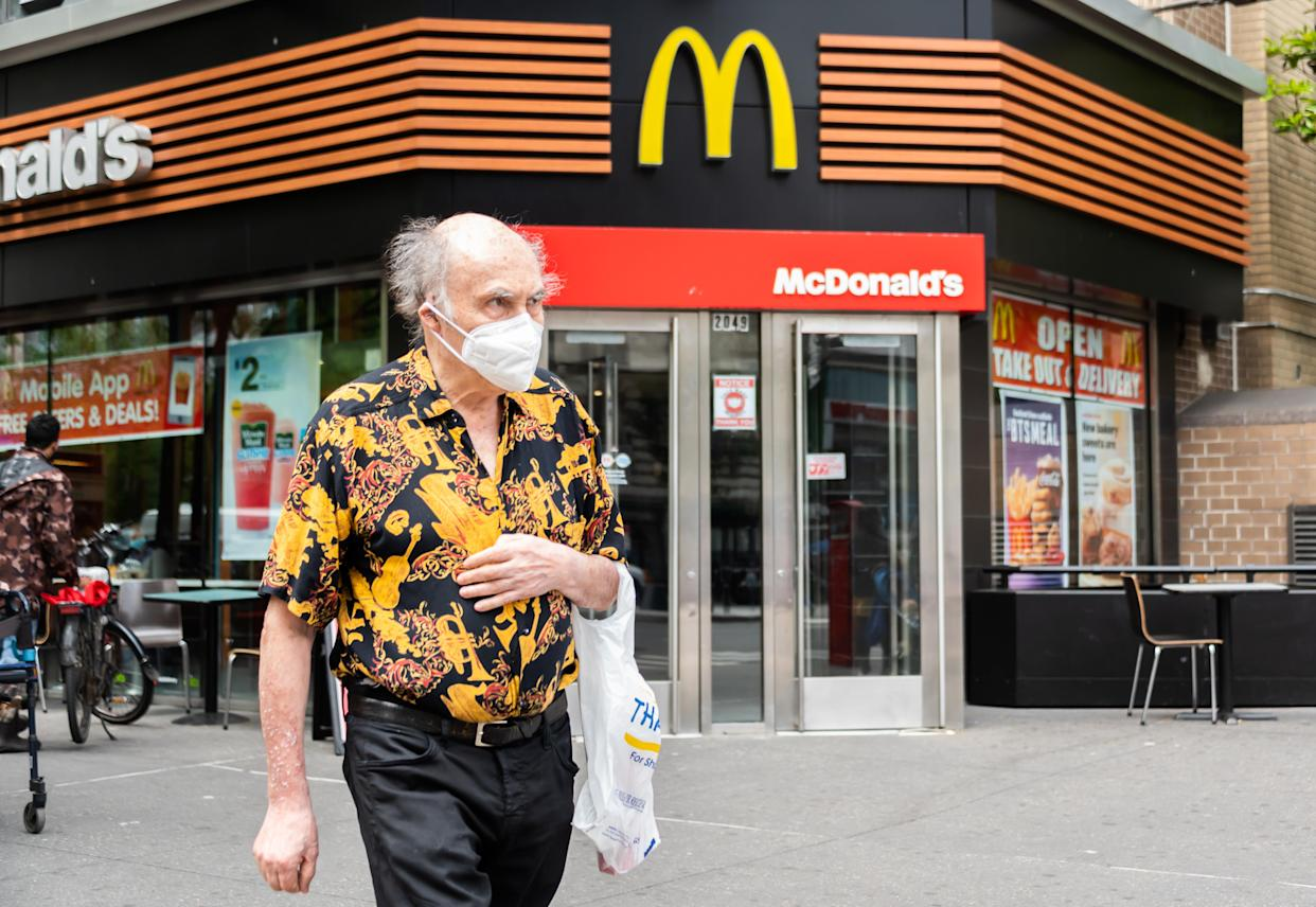 A person wears a face mask outside McDonald's on the Upper West Side on May 28, 2021 in New York City. On May 19, all pandemic restrictions, including mask mandates, social distancing guidelines, venue capacities and restaurant curfews were lifted by New York Governor Andrew Cuomo. (Noam Galai/Getty Images)