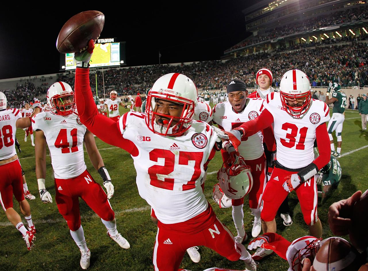 EAST LANSING, MI - NOVEMBER 03:  Charles Jackson #27 of the Nebraska Cornhuskers celebrates a 28-24 win over the Michigan State Spartans as time expires in the fourth quarter at Spartan Stadium Stadium on November 3, 2012 in East Lansing, Michigan. (Photo by Gregory Shamus/Getty Images)
