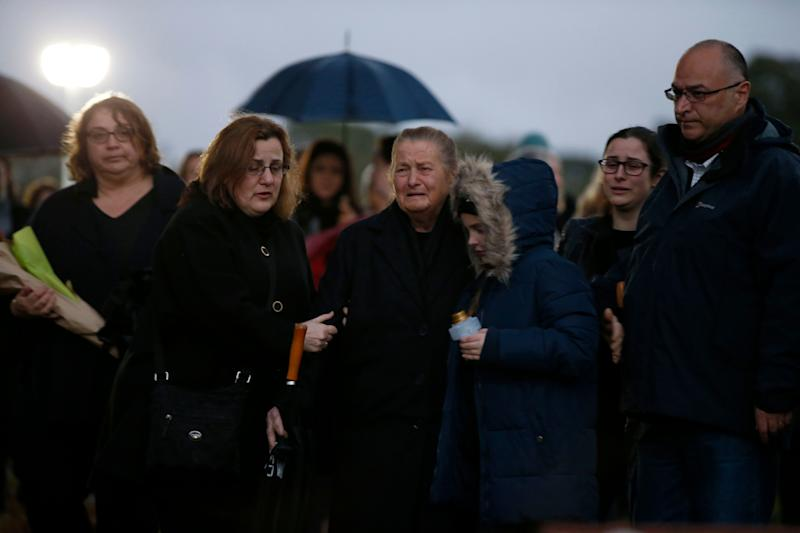 Mourners gather at the park dressed in dark clothing to honour Courtney.