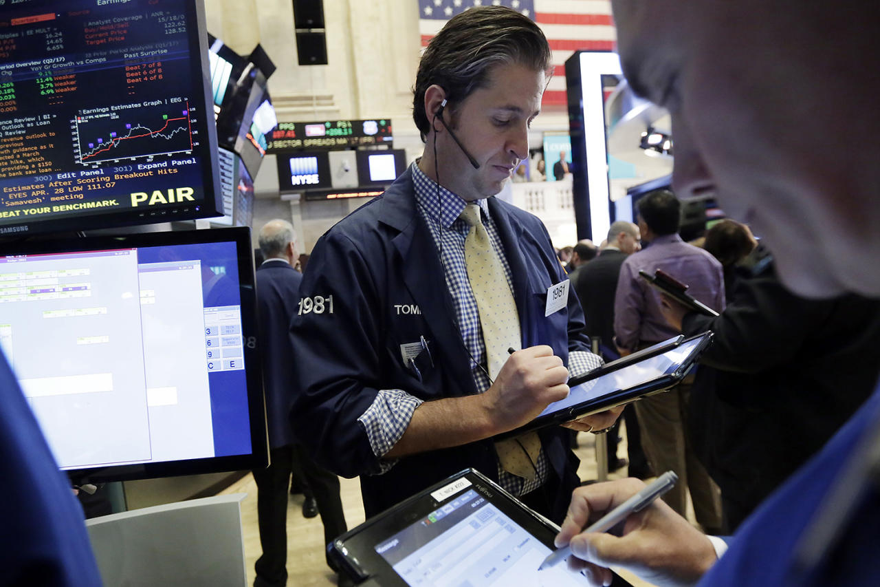 <p>Trader Thomas Donato, center, works on the floor of the New York Stock Exchange, May 17, 2017. Stocks are opening lower on Wall Street as banks and industrial companies fall. (Photo: Richard Drew/AP) </p>