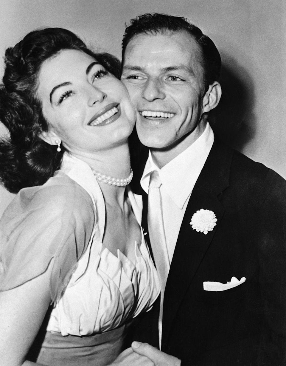<p>Frank Sinatra and actress Ava Gardner are all smiles during their 1951 marriage ceremony in Germantown, PA. The couple stayed together until 1957. The rocky marriage was the last for Gardner, while Sinatra carried through with several more high-profile marriages. </p>