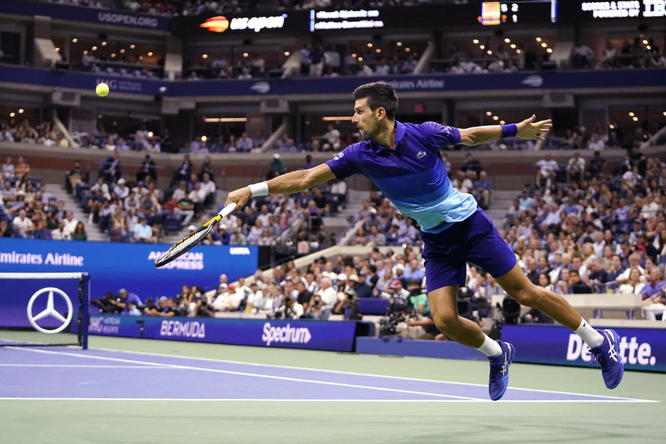 Novak Djokovic, of Serbia, stretches to hit a return to Matteo Berrettini, of Italy, during the quarterfinals of the U.S. Open tennis tournament Wednesday, Sept. 8, 2021, in New York. (AP Photo/Frank Franklin II)