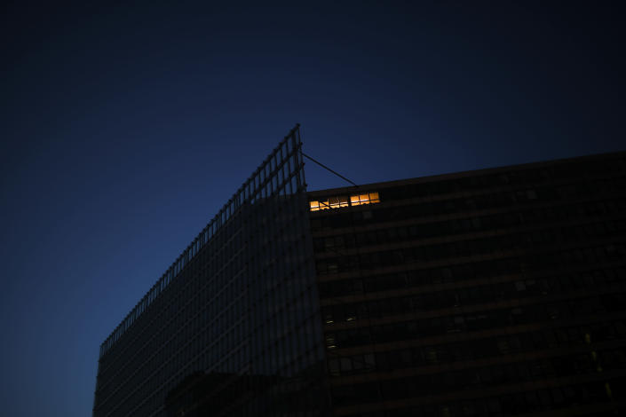 A light is on at the EU Charlemagne building during a partial lockdown ordered by Belgium government in Brussels, Monday, March 23, 2020. For some people the COVID-19 coronavirus causes mild or moderate symptoms, but for some it causes severe illness. (AP Photo/Francisco Seco)