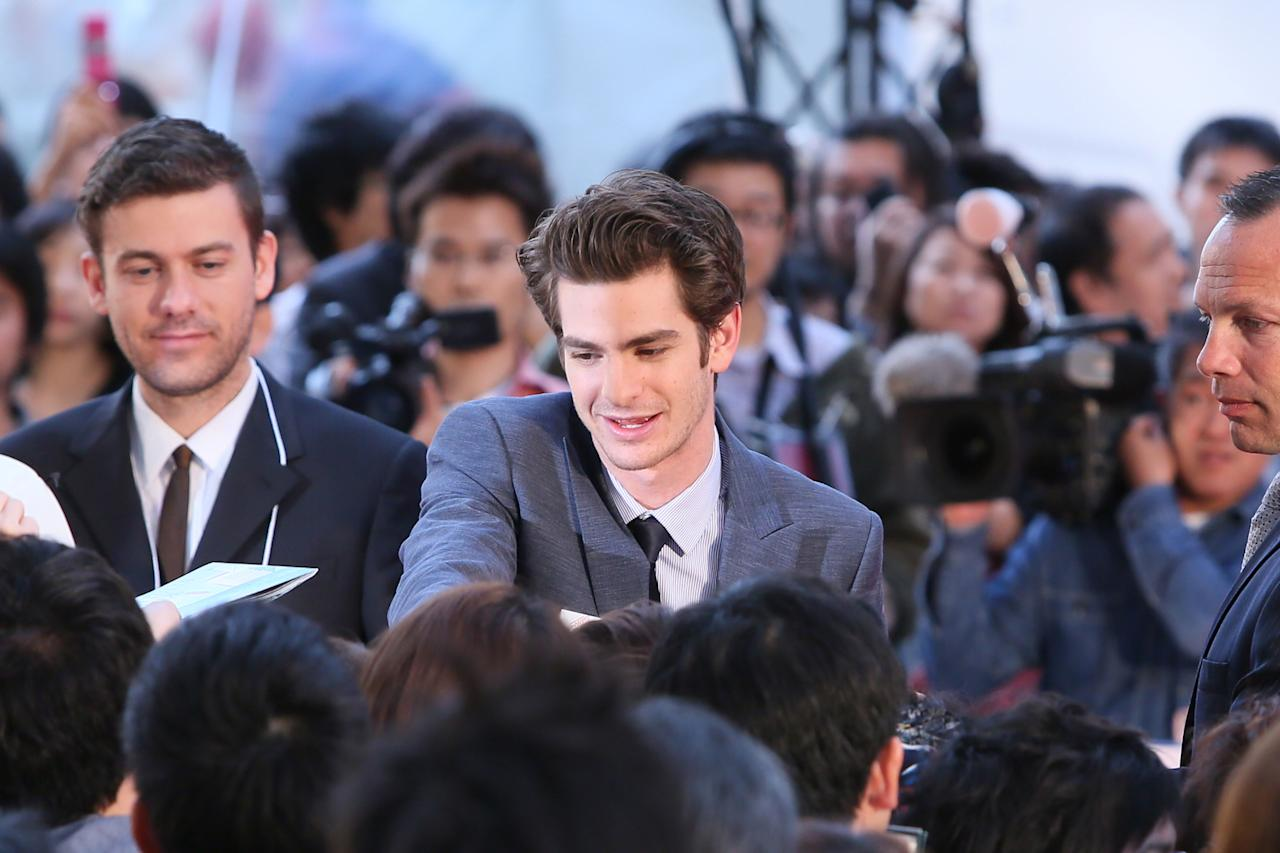 TOKYO, JAPAN - JUNE 13:  Actor Andrew Garfield signs autographs for fans during the world Premiere of 'The Amazing Spider-Man' at Roppongi Hills on June 13, 2012 in Tokyo, Japan. The film will open on June 30 in Japan.  (Photo by Ken Ishii/Getty Images)