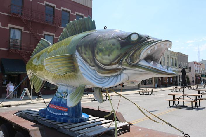 """""""Wylie Walleye"""" has been a popular feature of """"Meals on Madison,"""" an outside patio dining area in downtown Port Clinton, Ohio. A fiberglass Wylie is traditionally dropped on New Year's Eve."""