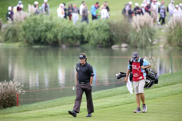 Phil Mickelson of the United States walks toward to the 9th green during the first round of the Shanghai HSBC Champions golf tournament at the Sheshan International Golf Club in Shanghai, China, Thursday, Oct. 31, 2013. (AP Photo/Eugene Hoshiko)