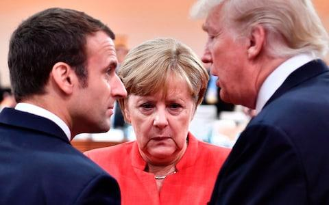 French President Emmanuel Macron, German Chancellor Angela Merkel and US President Donald Trump during the 2017 G20. - Credit: AFP