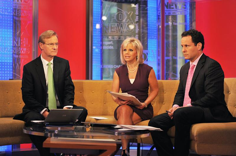 Carlson on Fox & Friends with Steve Doocy (left) and Brian Kilmeade (Getty Images)