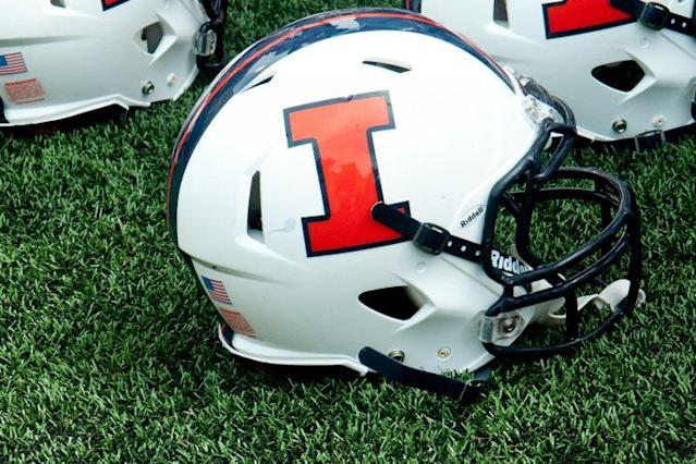 Three Illinois football players were arrested Wednesday on home invasion and armed robbery charges. (AP)