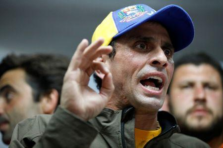 Venezuelan opposition leader and Governor of Miranda state Henrique Capriles speaks during a news conference in Caracas