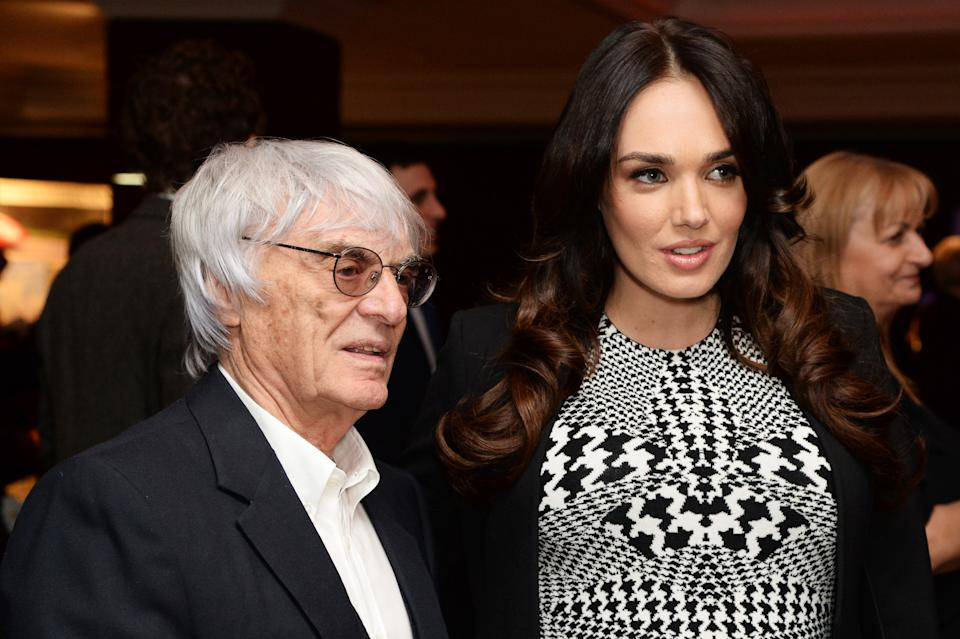 Bernie Ecclestone and Tamara Ecclestone attend a Formula 1 charity photographic auction at The Intercontinental Hotel on February 07, 2014 in London, England.  (Photo by Dave J Hogan/Getty Images)
