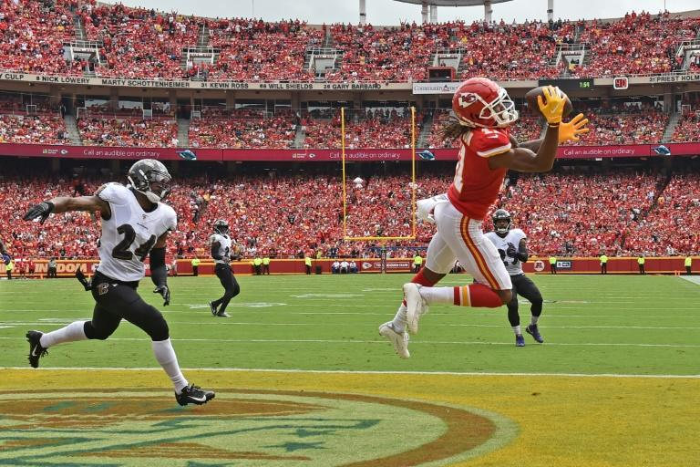 Kansas city wide receiver Demarcus Robinson snags a touchdown pass in the Chiefs' 33-28 NFL victory over the Baltimore Ravens