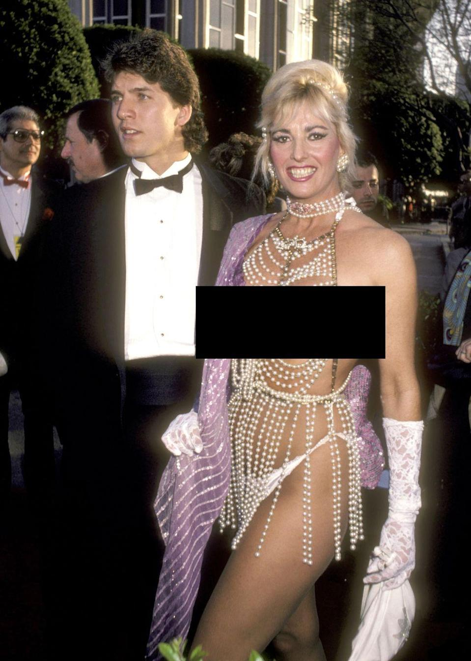 """<p>Actress Edy Williams was known for her provocative outfits, but none stand out quite as much as <a href=""""https://www.goodhousekeeping.com/life/entertainment/g5148/oscar-scandals/?slide=13"""" rel=""""nofollow noopener"""" target=""""_blank"""" data-ylk=""""slk:this 1986 getup"""" class=""""link rapid-noclick-resp"""">this 1986 getup</a>. Let's just say those pearls left very little to the imagination.</p>"""