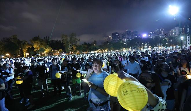 Protesters singing in Victoria Park. Photo: Felix Wong