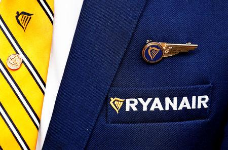 FILE PHOTO: Ryanair logo is pictured on the the jacket of a cabin crew member ahead of a news conference by Ryanair union representatives in Brussels, Belgium September 13, 2018.   REUTERS/Francois Lenoir