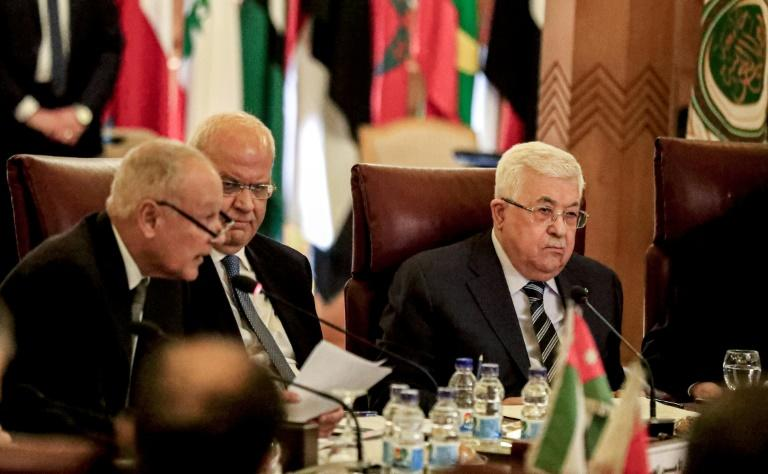 Palestinian president Mahmud Abbas (R) and Palestine Liberation Organisation Secretary-General Saeb Erekat (C) attended the extraordinary meeting of the Arab League held in Cairo on Saturday in response to the unveiling of the US peace plan (AFP Photo/Khaled DESOUKI)