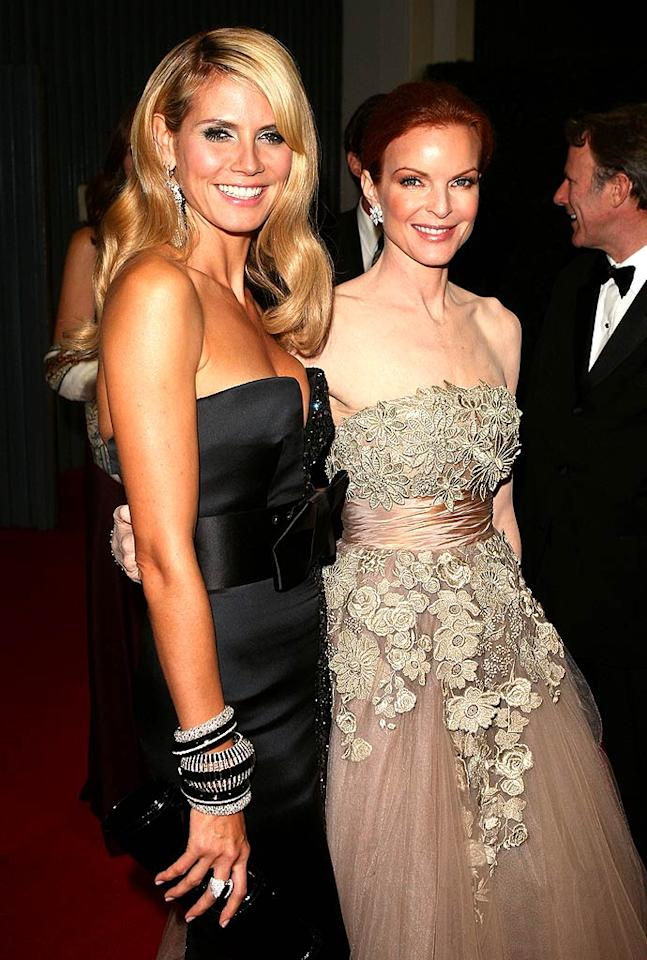 "In spite of bombing as host of the 60th Annual Emmy Awards, supermodel Heidi Klum was all smile as she entered the Governor's Ball with Marcia Cross. Jason Merritt/<a href=""http://filmmagic.com/"" target=""new"">FilmMagic.com</a> - September 21, 2008"