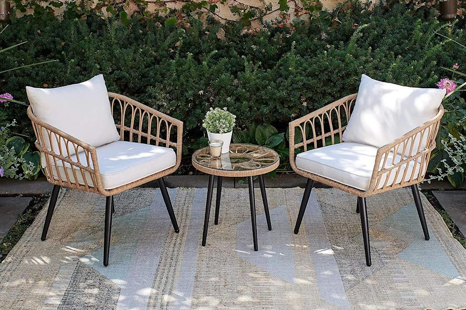 """<p><strong>Quality Outdoor Living</strong></p><p>amazon.com</p><p><strong>$399.99</strong></p><p><a href=""""https://www.amazon.com/dp/B08MWY6L7T?tag=syn-yahoo-20&ascsubtag=%5Bartid%7C10052.g.37721992%5Bsrc%7Cyahoo-us"""" rel=""""nofollow noopener"""" target=""""_blank"""" data-ylk=""""slk:Shop Now"""" class=""""link rapid-noclick-resp"""">Shop Now</a></p><p>Over the past year, outdoor entertaining has become a bigger part of everyone's homes. Make your back patio or front porch ready for guests with this five-star rated rattan set. Each cushion is weather and UV-ray resistant, meaning this furniture will last for years. (And if you're hosting larger outdoor parties, there are coordinating sets with larger outdoor sectionals.) </p>"""