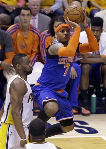 New York Knicks forward Carmelo Anthony, right, shoots in front of Indiana Pacers forward Sam Young during the first half of Game 3 of the Eastern Conference semifinal NBA basketball playoff series in Indianapolis, Saturday, May 11, 2013. (AP Photo/Michael Conroy)