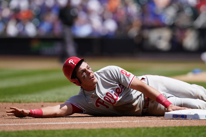Philadelphia Phillies' Nick Maton reacts at third base after diving back for an attempted putout during the second inning of a baseball game against the New York Mets, Sunday, June 27, 2021, in New York. Maton was initially ruled out but found to be safe after a video review. He scored on Odubel Herrera's sacrifice fly. (AP Photo/Kathy Willens)