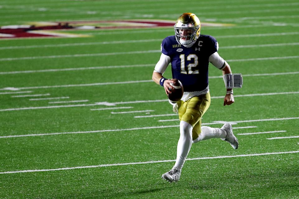 CHESTNUT HILL, MASSACHUSETTS - NOVEMBER 14: Ian Book #12 of the Notre Dame Fighting Irish runs the ball in for a touchdown against the Boston College Eagles during the second half at Alumni Stadium on November 14, 2020 in Chestnut Hill, Massachusetts. (Photo by Maddie Meyer/Getty Images)