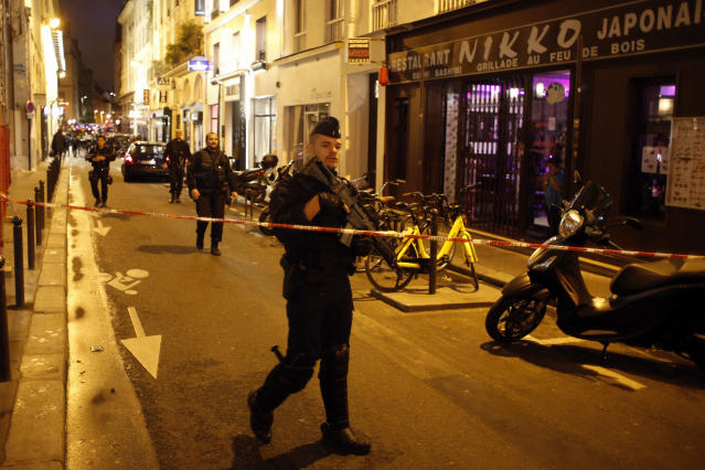 <p>A police officer cordons off the area after a knife attack in central Paris, Saturday May 12, 2018. (Photo: Thibault Camus/AP) </p>