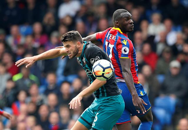 <p>Christian Benteke in action with Southampton's Wesley Hoedt REUTERS/David Klein </p>