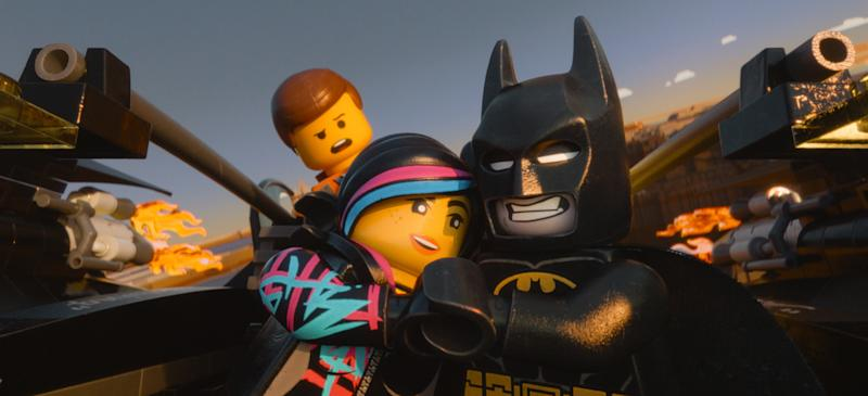 "This image released by Warner Bros. Pictures shows characters, from left, Emmet, voiced by Chris Pratt, Wyldstyle, voiced by Elizabeth Banks and Batman, voiced by Will Arnett, in a scene from ""The Lego Movie."" (AP Photo/Warner Bros. Pictures)"