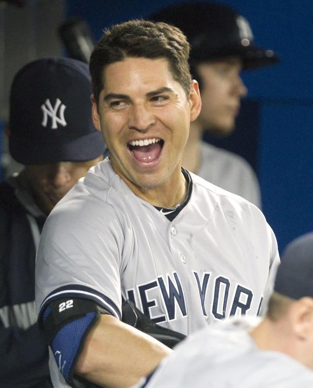 New York Yankees' Jacoby Ellsbury smiles after hitting a two-run home run against the Toronto Blue Jays during the seventh inning of a baseball game Friday, Aug. 29, 2014, in Toronto. (AP Photo/The Canadian Press, Fred Thornhill)