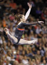 McKayla Maroney competes on the floor exercise during the final round of the U.S. gymnastics championships. Maroney placed second in the All-Around. (AP Photo/Genevieve Ross)