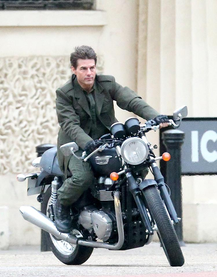 Tom cruise rides a motorbike, without a crash helmet down The Mall filming an action scene for his latest movie 'All You Need Is Kill' in London, UK. Pictured: Tom Cruise Ref: SPL495997  240213  Picture by: Paul Hennessy/Splash News   Splash News and Pictures Los Angeles:310-821-2666 New York:212-619-2666 London:870-934-2666 photodesk@splashnews.com