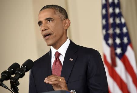 U.S. President Barack Obama delivers a live televised address to the nation on his plans for military action against the Islamic State, from the Cross Hall of the White House in Washington September 10, 2014. REUTERS/Saul Loeb/Pool