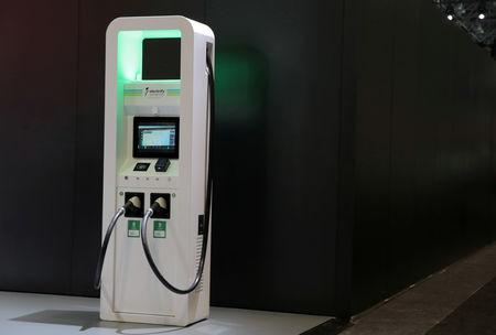 FILE PHOTO: FILE PHOTO: An electric vehicle charging station is seen on display at the 2019 New York International Auto Show in New York City, New York, U.S, April 17, 2019. REUTERS/Brendan McDermid/File Photo