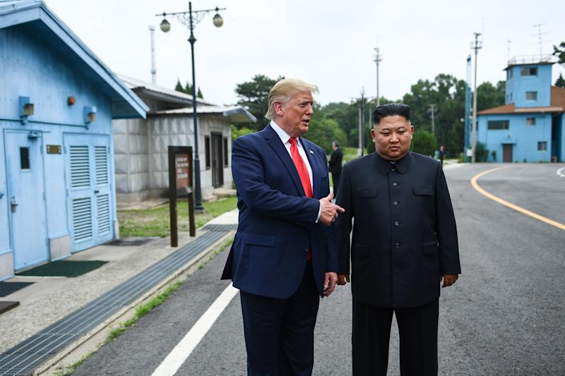 North Korea's leader Kim Jong Un stands with US President Donald Trump south of the Military Demarcation Line that divides North and South Korea, in the Joint Security Area (JSA) of Panmunjom in the Demilitarized zone (DMZ) on June 30, 2019. (Photo by Brendan Smialowski / AFP) (Photo credit should read BRENDAN SMIALOWSKI/AFP/Getty Images)