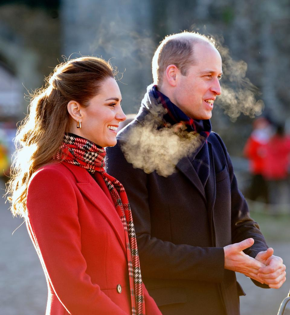 Britain's Prince William, Duke of Cambridge (R), and Britain's Catherine, Duchess of Cambridge (L) smile during a visit to Cardiff Castle in Cardiff in south Wales on December 8, 2020, on the final day of engagements on their tour of the UK. - During their trip, their Royal Highnesses hope to pay tribute to individuals, organisations and initiatives across the country that have gone above and beyond to support their local communities this year. (Photo by Jonathan Buckmaster / POOL / AFP) (Photo by JONATHAN BUCKMASTER/POOL/AFP via Getty Images)