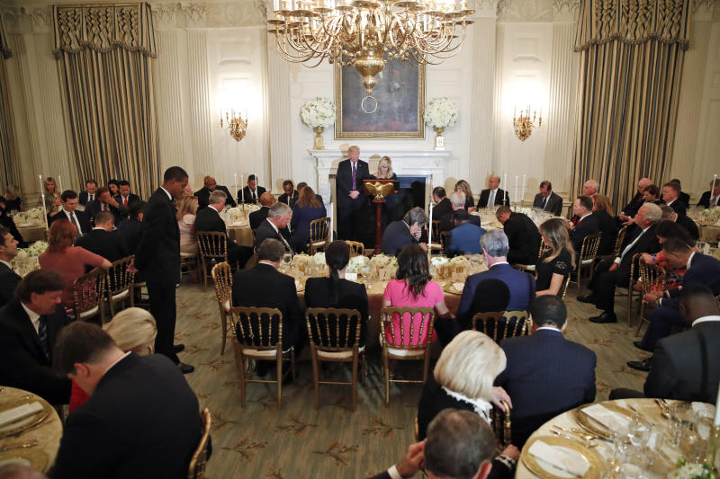 President Donald Trump bows his head in prayer as pastor Paula White leads the room in prayer during a dinner for evangelical leaders in the State Dining Room of the White House, Monday, Aug. 27, 2018, in Washington, D.C. (Alex Brandon / ASSOCIATED PRESS)