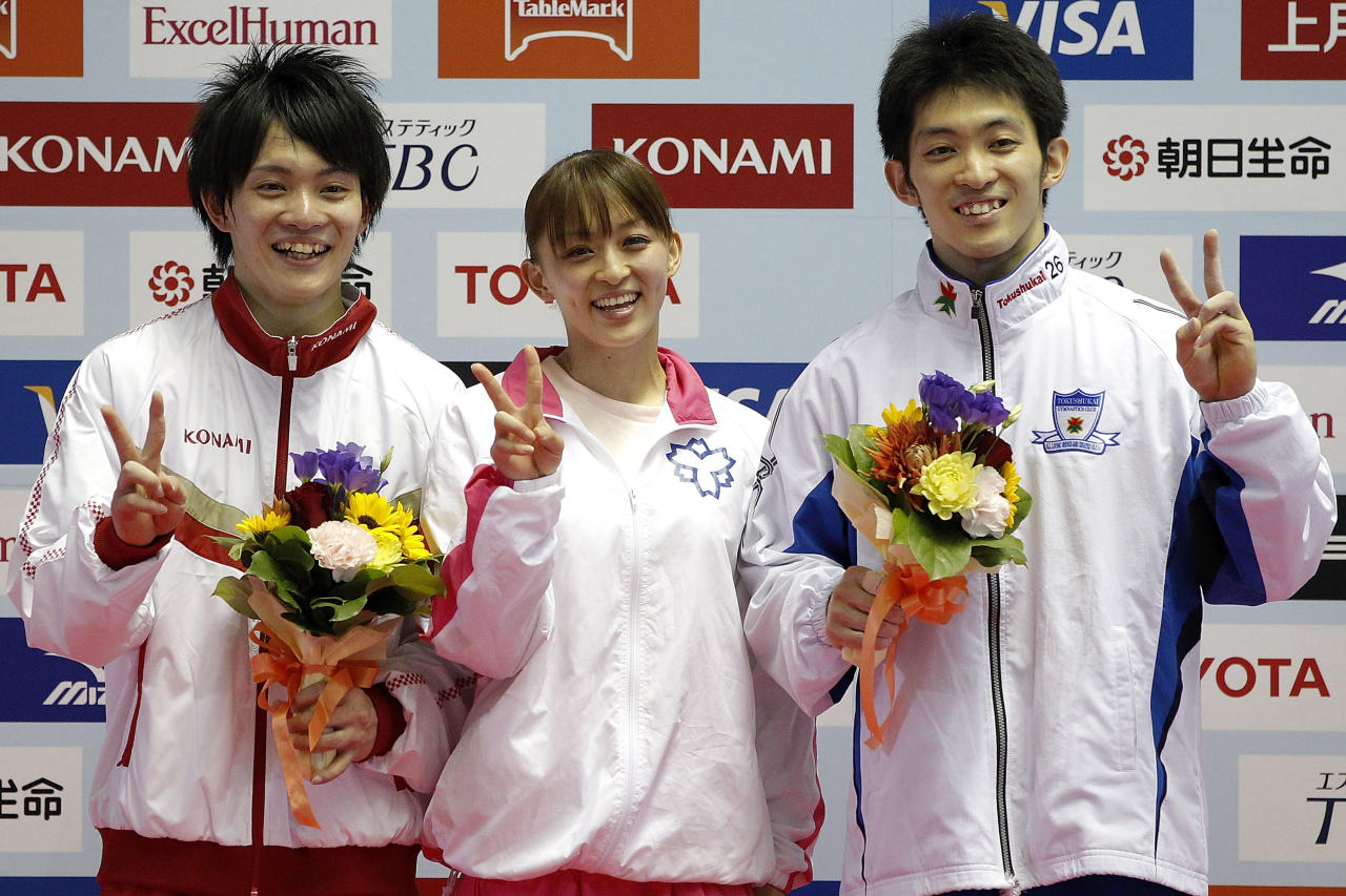 TOKYO, JAPAN - MAY 05:  Rie Tanaka (C) poses with her younger brother Yusuke Tanaka (L) and older brother Kazuhito Tanaka as they are qualified for the Japan gymnastics team for the London 2012 Olympic Games after all the competition during day two of the 51st Artistic Gymnastics NHK Trophy at Yoyogi National Gymnasium on May 5, 2012 in Tokyo, Japan.  (Photo by Kiyoshi Ota/Getty Images)