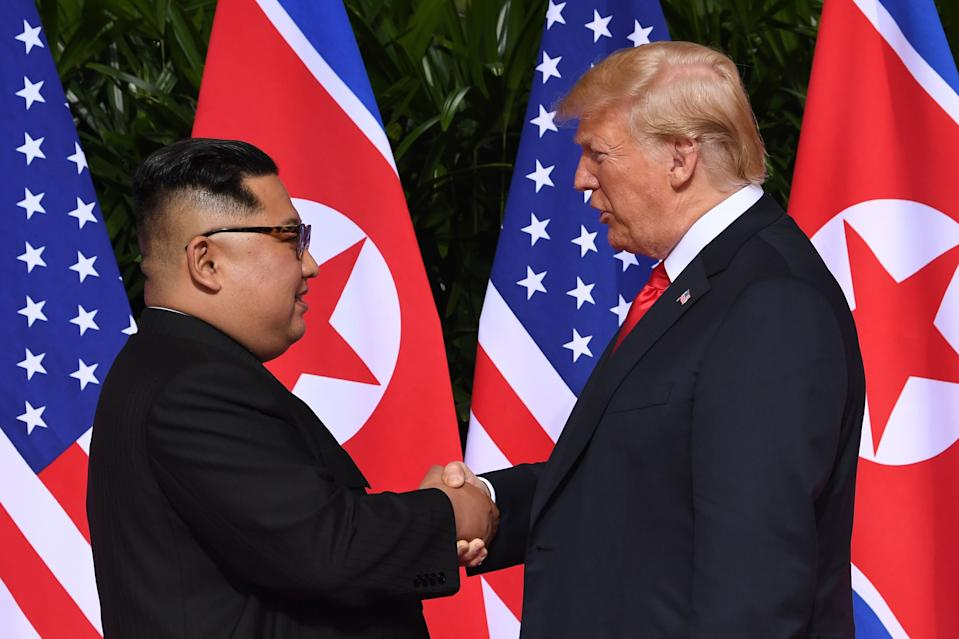 North Korea's leader Kim Jong Un shakes hands with US President Donald Trump at the start of their historic US-North Korea summit at the Capella Hotel on Sentosa on 12 June 2018. (Photo: AFP via Getty Images)