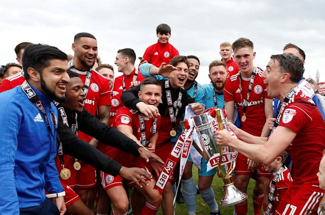 "Soccer Football - League Two - Accrington Stanley v Lincoln City - Wham Stadium, Accrington, Britain - April 28, 2018 Accrington Stanley players celebrate with the trophy at the end of the match Action Images/Andrew Boyers EDITORIAL USE ONLY. No use with unauthorized audio, video, data, fixture lists, club/league logos or ""live"" services. Online in-match use limited to 75 images, no video emulation. No use in betting, games or single club/league/player publications. Please contact your account representative for further details."