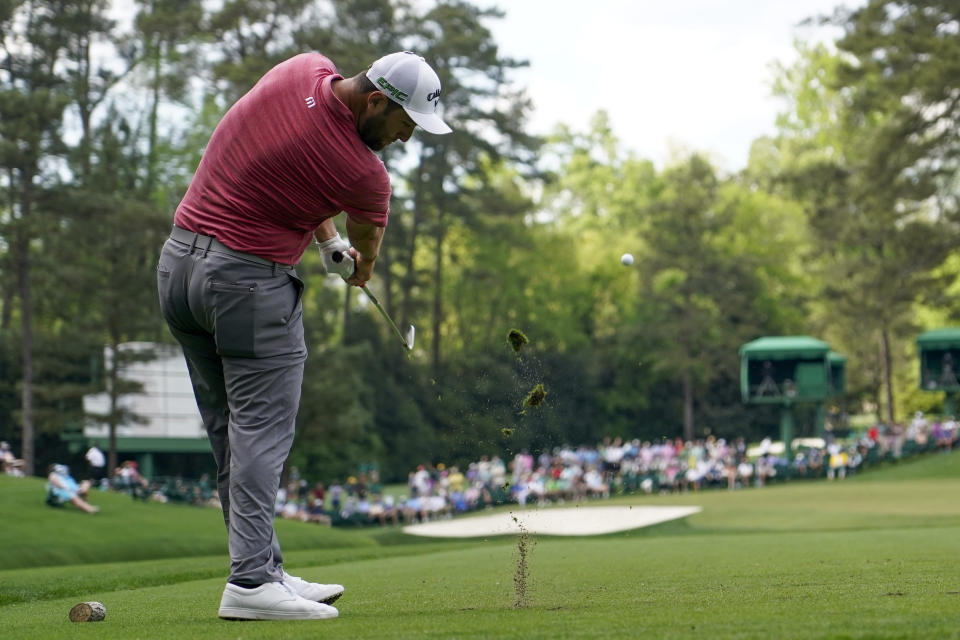 Jon Rahm, of Spain, hits his tee shot on the 16th hole during the final round of the Masters golf tournament on Sunday, April 11, 2021, in Augusta, Ga. (AP Photo/David J. Phillip)