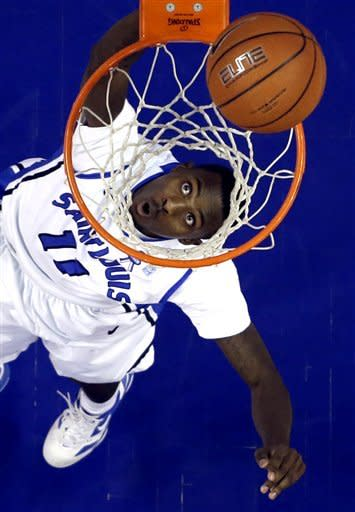 Saint Louis' Mike McCall Jr. watches as his layup falls in during the first half of an NCAA college basketball game against Butler on Thursday, Jan. 31, 2013, in St. Louis. (AP Photo/Jeff Roberson)