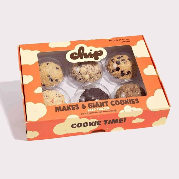 """<p>chipcitycookies.com</p><p><strong>$75.00</strong></p><p><a href=""""https://chipcitycookies.com/custom-cookies/"""" rel=""""nofollow noopener"""" target=""""_blank"""" data-ylk=""""slk:Shop Now"""" class=""""link rapid-noclick-resp"""">Shop Now</a></p><p>Is she a) a serious cookie enthusiast who is b) too busy to whip up a batch of her own? Save the day with this bundle of <strong>12 giant pre-shaped balls of dough</strong>. Just pop them in the oven and enjoy.</p>"""