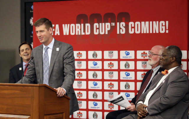 Sporting Kansas City President and CEO Jake Reid speaks during a news conference after North America's successful bid to land the 2026 World Cup, at Arrowhead Stadium after in Kansas City, Mo., Wednesday, June 13, 2018. Kansas City Chiefs President Mark Donovan, left, and Kansas City Kansas Mayor David Alvey and Kansas City Missouri Mayor Sly James, right, join in the conference. (AP Photo/Orlin Wagner)