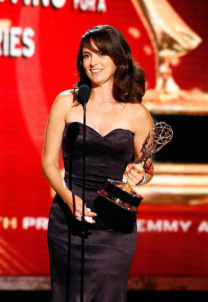 """30 Rock's"" Tina Fey is a serious triple threat! The funny lady took home three Emmys last Sunday night for acting, writing, and producing! Mathew Imaging/<a href=""http://www.wireimage.com"" target=""new"">WireImage.com</a> - September 16, 2008"