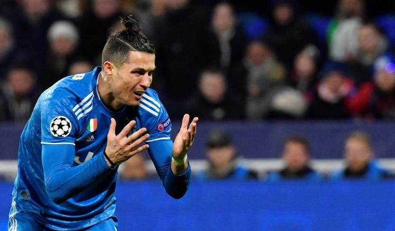 Juventus star Cristiano Ronaldo shows his frustration during last week's Champions League loss at Lyon (AFP Photo/Philippe DESMAZES)