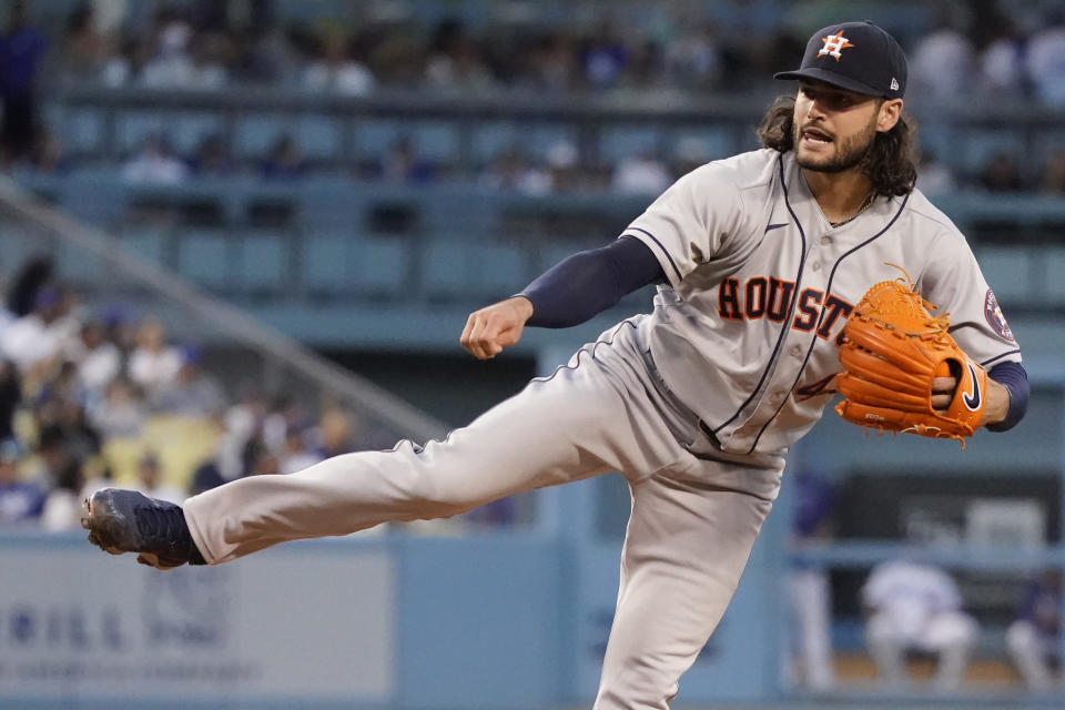 Houston Astros starting pitcher Lance McCullers Jr. watches a delivery to a Los Angeles Dodgers batter during the second inning of a baseball game Tuesday, Aug. 3, 2021, in Los Angeles. (AP Photo/Marcio Jose Sanchez)