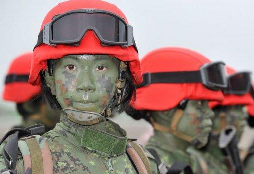 A group of Taiwanese paratroops pose for photos after a drill