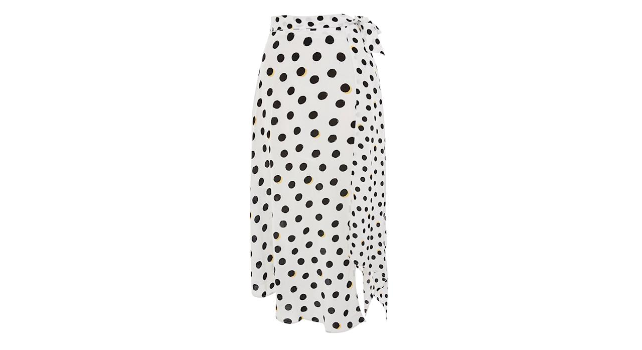 "<p>This wrap polka dot skirt is a great, transitional piece. Pair it with a chunky knit now and wear it again in the summer with a simple tee. <a rel=""nofollow"" href=""http://topshop.com""><em>Buy here.</em></a> </p>"