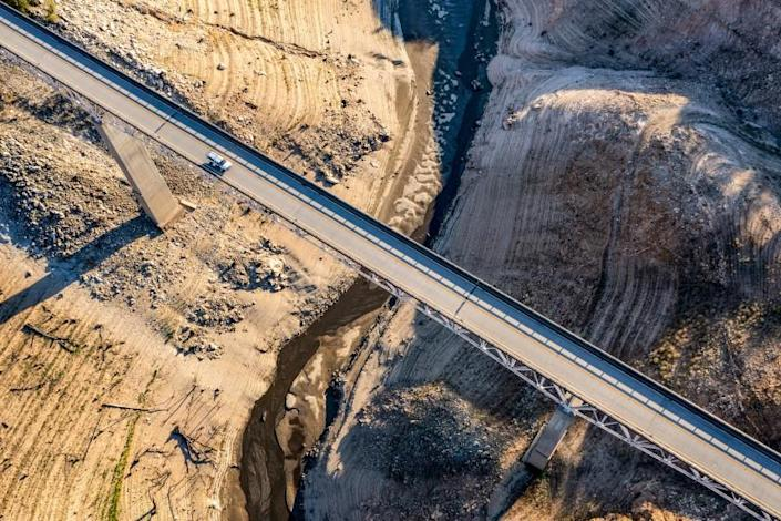 OROVILLE, CA - JUNE 30: A truck crosses the Enterprise Bridge at Lake Oroville, which stands at 33 percent full and 40 percent of historical average when this photograph was taken on Wednesday, June 30, 2021 in Oroville, CA. (Brian van der Brug / Los Angeles Times)