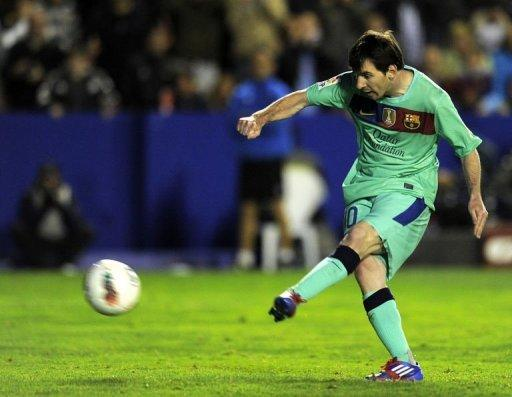 Barcelona's forward Lionel Messi scores a goal during their Spanish La Liga match against Levante at the Ciutat de Valencia stadium. Messi went level with Cristiano Ronaldo's record of 41 league goals for the season on Saturday when he scored twice in Barcelona's come-from-behind 2-1 win